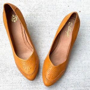 Anthropologie Miss Albright Mustard yellow heels